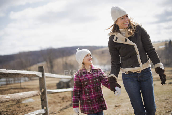 Woman and child walking on a farm — Stock Photo