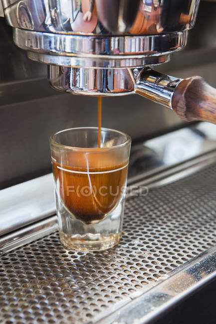 Espresso poured from espresso machine — Stock Photo
