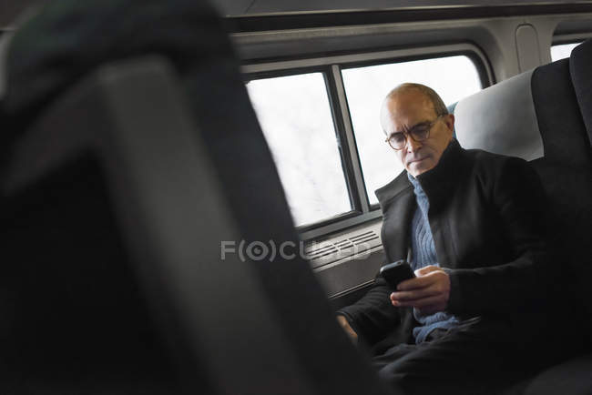 Mature man in train — Stock Photo