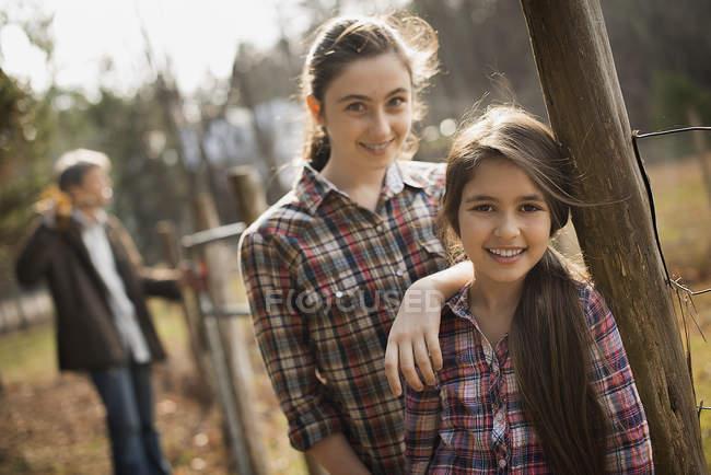 Girls beside a paddock fence — Stock Photo