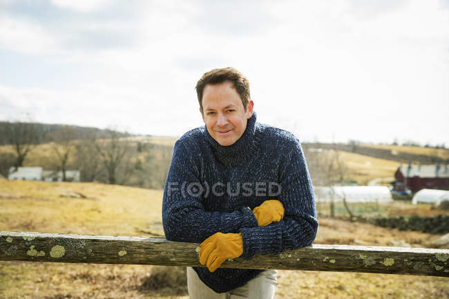 Man working outdoors on the farm. — Stock Photo