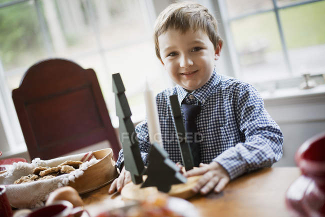 Boy with large tray of biscuits. — Stock Photo