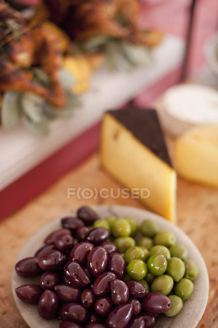Plate of green and black olives — Stock Photo