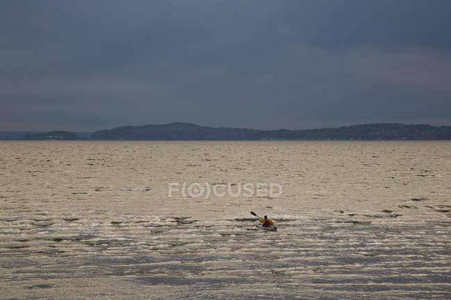Kayaker paddles his sea kayak — Stock Photo