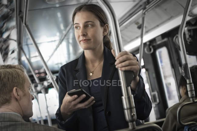 Business people on a bus in the city. — Stock Photo