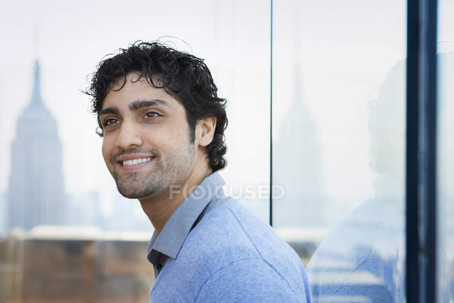 Man with black curly hair — Stock Photo