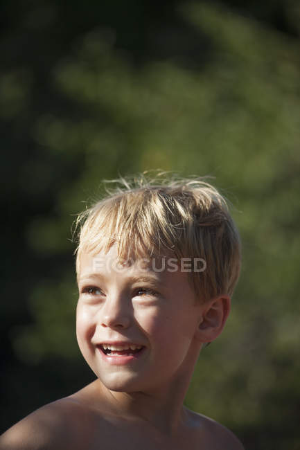 Child looking over his shoulders — Stock Photo