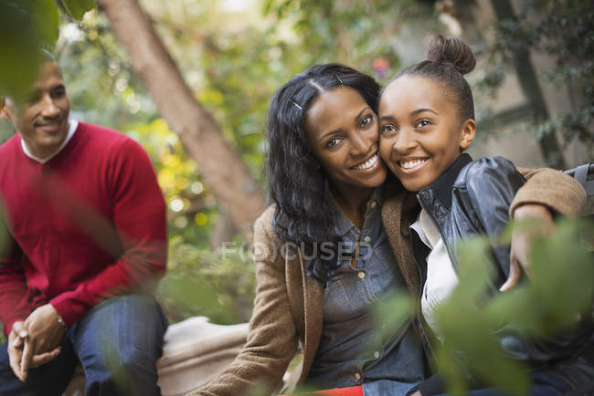 Mother and daughter hugging. — Stock Photo