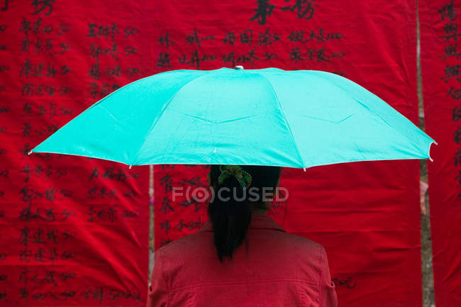 Woman under umbrella — Stock Photo