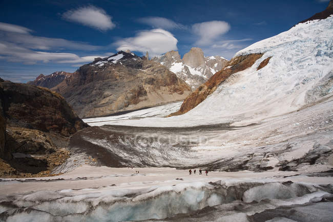 Several hikers on glacier — Stock Photo