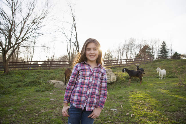 Girl in the goat paddock — Stock Photo