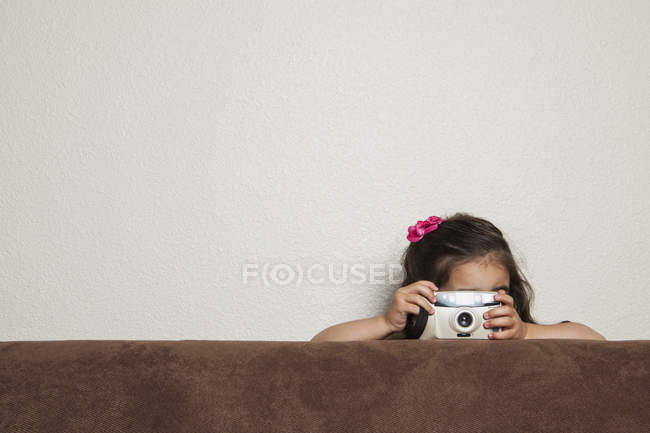 Girl with a toy camera — Stock Photo