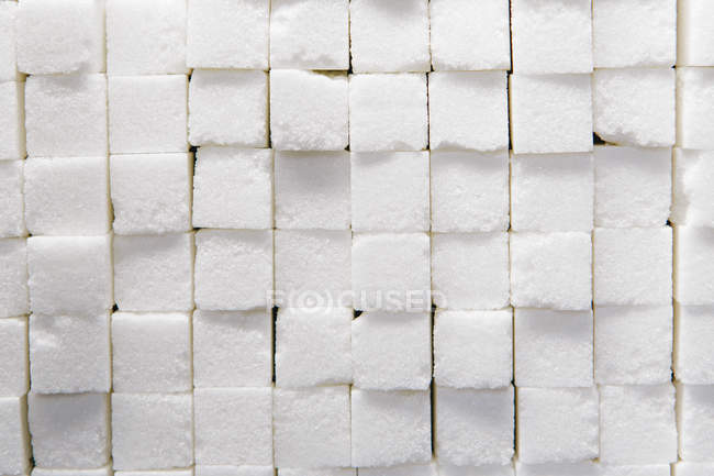 Stacked sugar cubes — Stock Photo