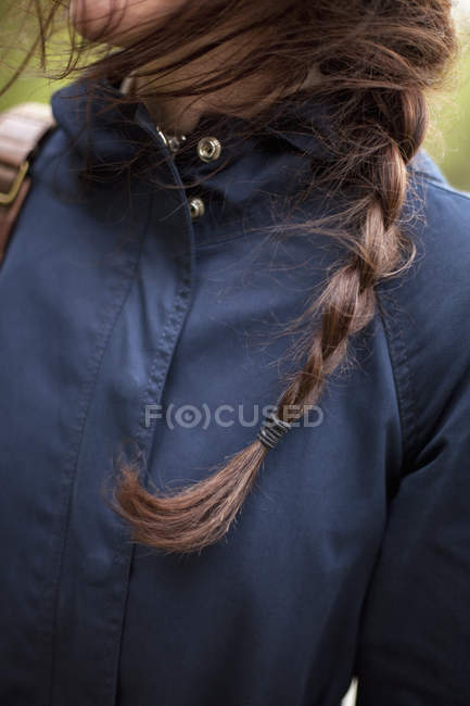 Woman with hair plaited in a braid — Stock Photo