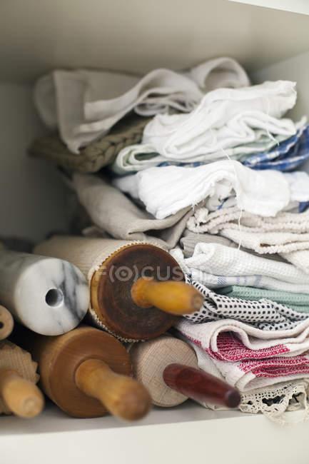 Shelf piled high with cloths — Stock Photo