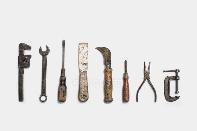 Used tools arranged in a row — Stock Photo