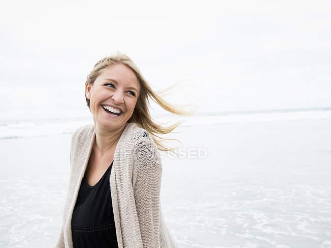 Woman walking on a beach — Stock Photo