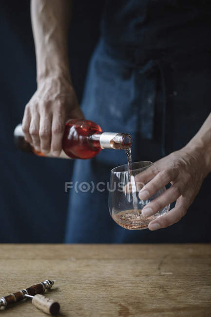 Man pouring a rose wine — Stock Photo
