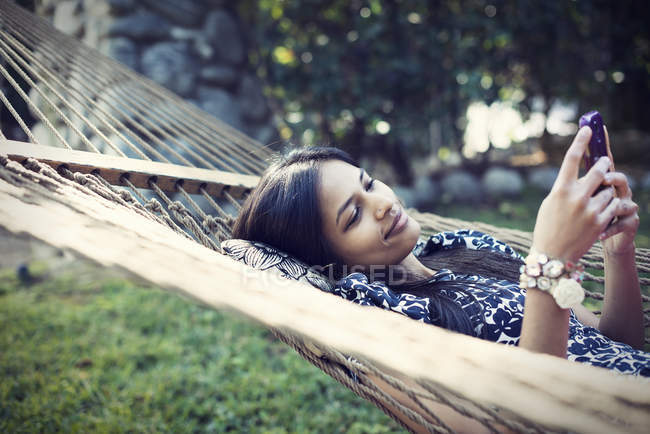 Woman lying in a large hammock — Stock Photo