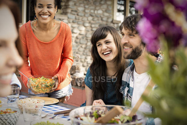Men and women laughing — Stock Photo