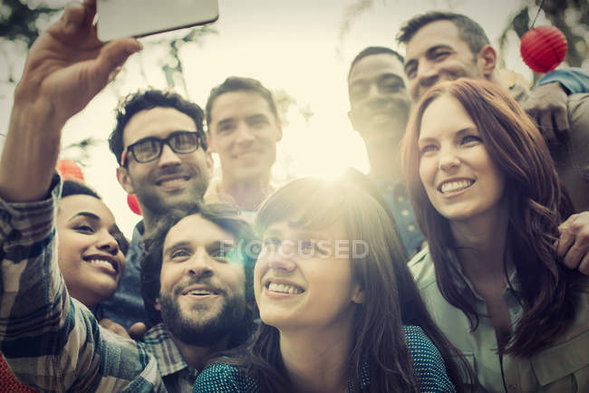 Friends gathering to take a group selfie. — Stock Photo