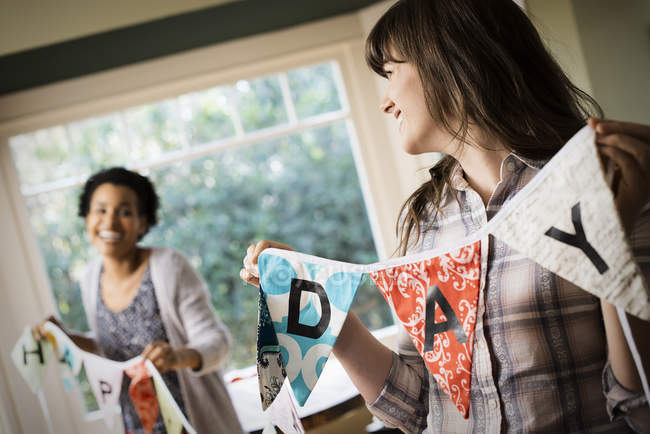 Women decorating for a party. — Stock Photo