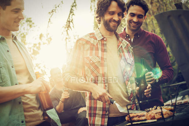 Friends at a summer evening barbeque. — Stock Photo