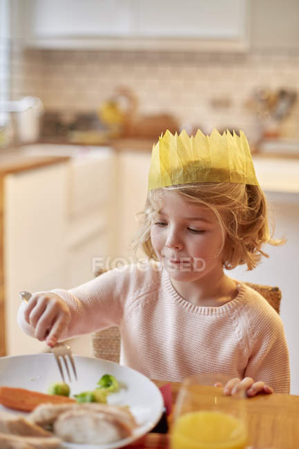Young girl wearing a party hat — Stock Photo