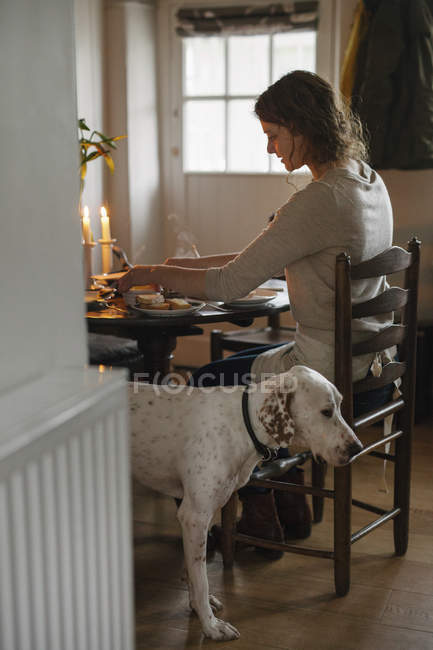 Woman and large dog beside her. — Stock Photo