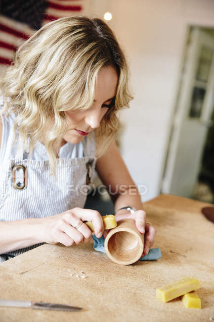 Woman in a workshop using a slab of wax — Stock Photo