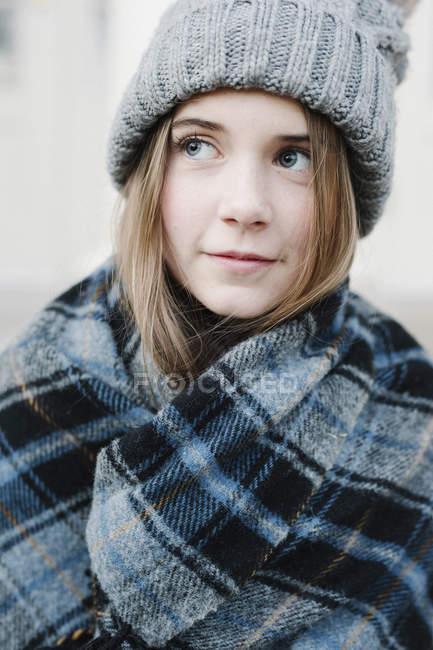 Teenage girl in a tartan plaid shawl — Stock Photo
