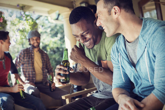 Men at a house party. — Stock Photo