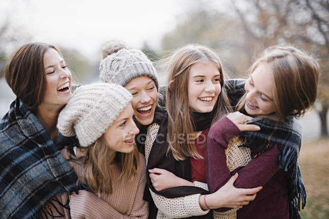 Girls in warm shawls and woolly hats — Stock Photo