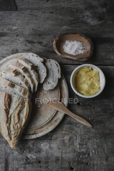 Dishes and bread laid out on table — Stock Photo