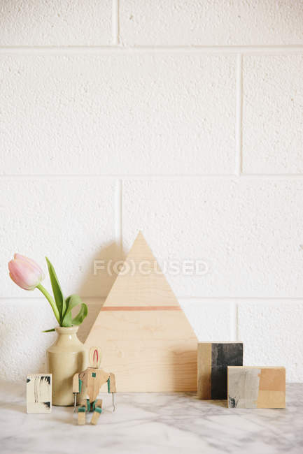 Stone worktop with a wooden triangle of wood — Stock Photo