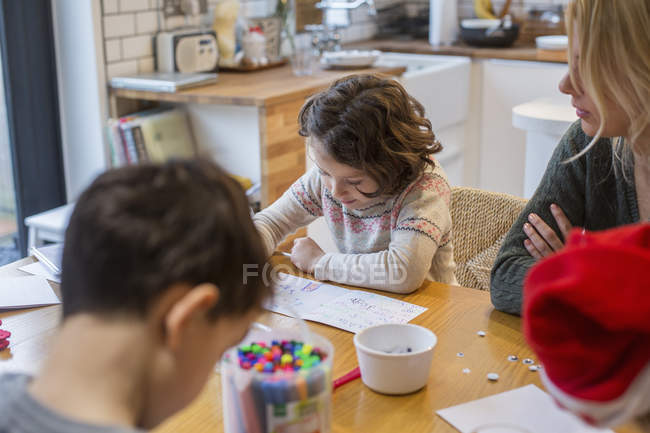 Children drawing cards and letters to Santa. — Stock Photo