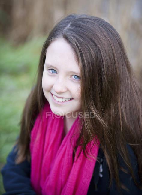 Teenage girl with long brown hair — Stock Photo