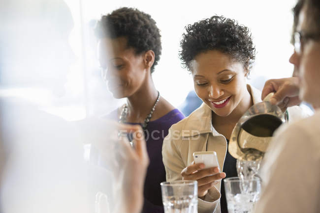 People sitting in cafe around table — Stock Photo