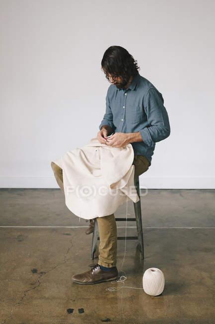 Man creating an art piece. — Stock Photo