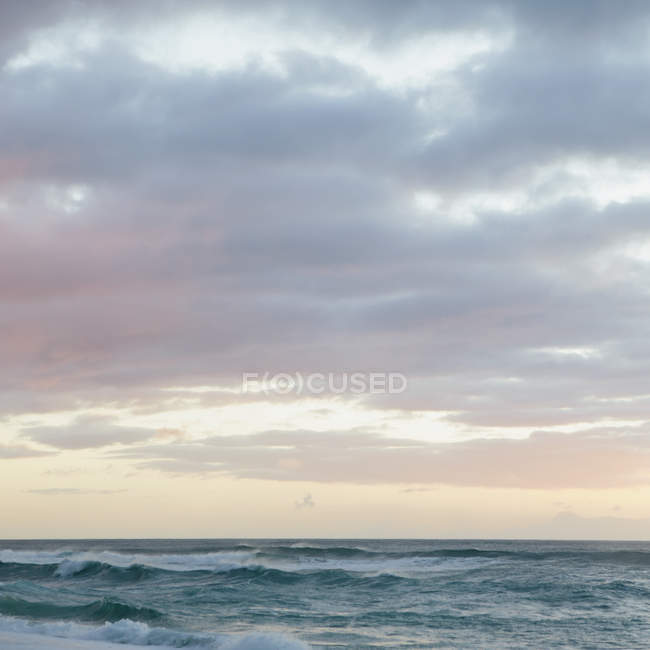 Waves and surf at dusk — Stock Photo