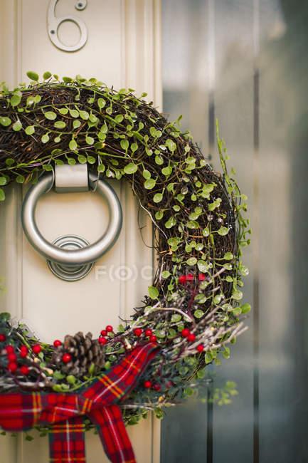 Christmas wreath on the front door — Stock Photo