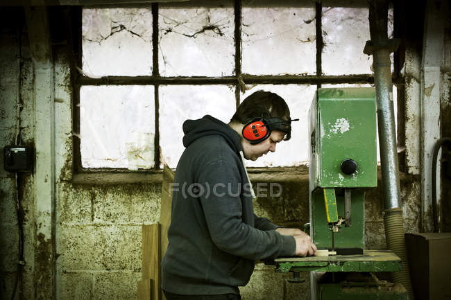 Man working in a furniture workshop. — Stock Photo