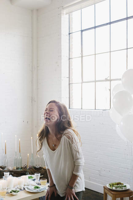 Woman laughing on her birthday — Stock Photo