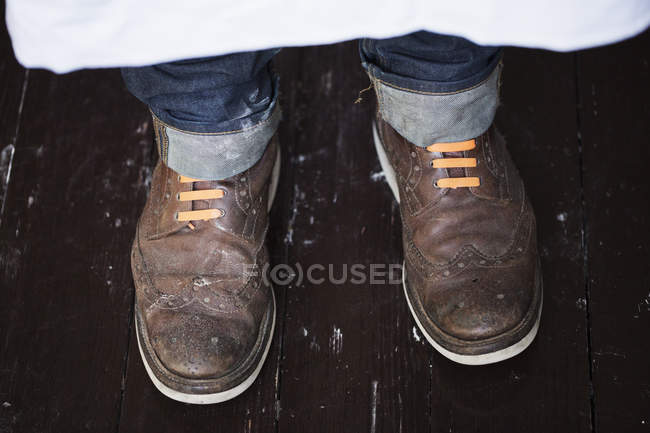 Baker wearing brown shoes — Stock Photo