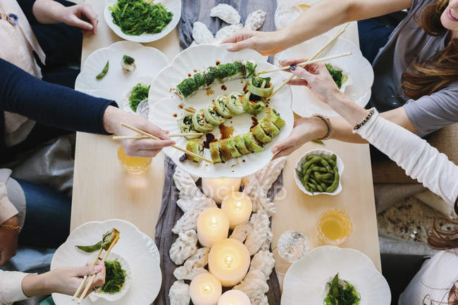 Overhead view of people sharing meal — Stock Photo