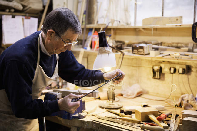 Man working on a piece of wood — Stock Photo