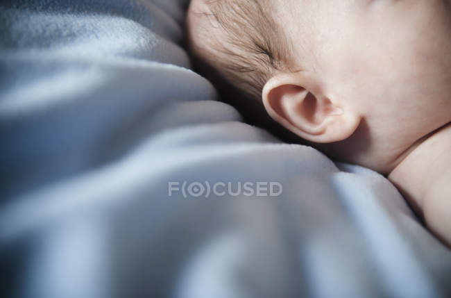 Baby's head and ear — Stock Photo