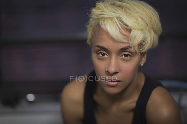 Woman with blonde hair looking at camera — Stock Photo