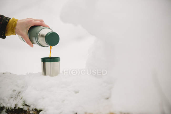Pouring a drink from a flask — Stock Photo