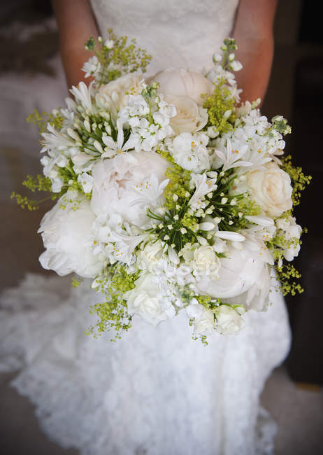 Bride holding bridal bouquet — Stock Photo